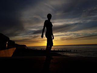 silhouette sunset beach england clouds