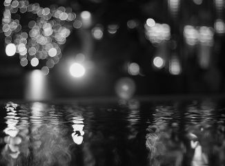 city lights reflection water