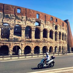 italy rome coliseum motorcycle people