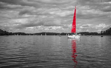 blackandwhite trakai lake boat red