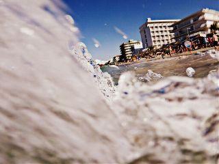 beach wave water drops people
