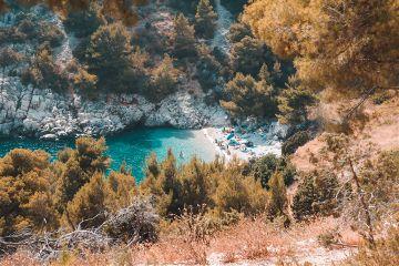 croatia beach cliff people turquoise