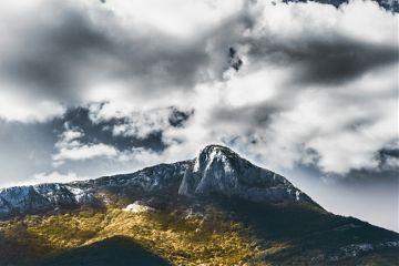 mountain forest sunshine golden clouds