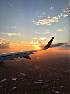 airplane sunset skies clouds