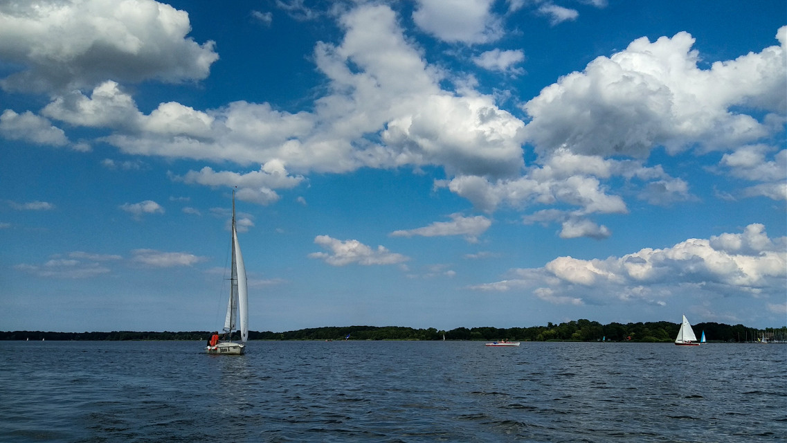 ...i am sailin'🎤🎵🎶🎼...  #freetoedit #water #sailing #sailingboat #photography #onthewater #onmyway #blue #sky #clouds #free