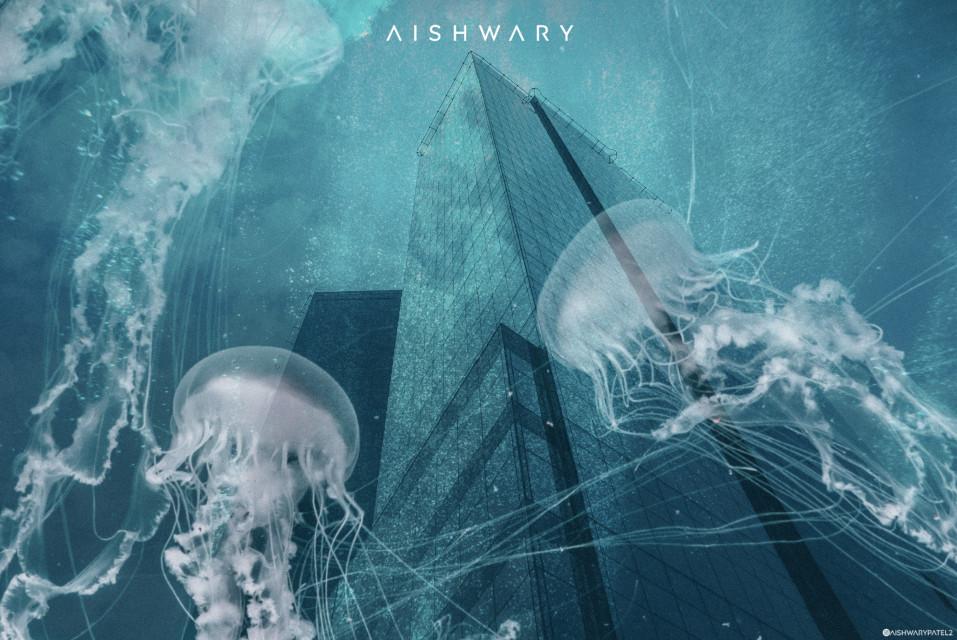 Jellyfishes around! Images by-@unsplash Artists-Sarah lee & Joel filipe      #freetoedit#unsplash#jellyfish#underwater#water#drowning#city#submerged#building#blue#sparkles#surreal#manipulation#surrealism