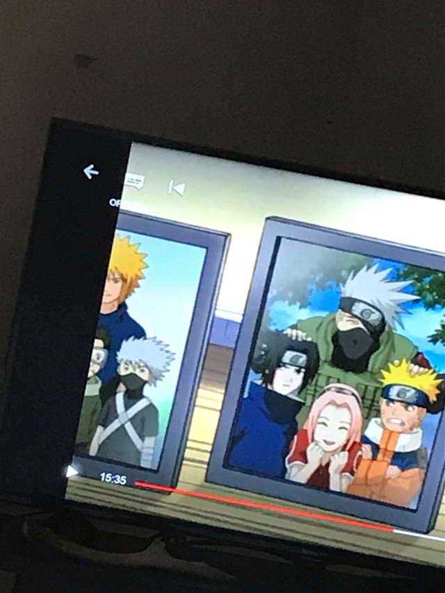 Look to the left the guy next to young kakashi maybe this was the original character design for young obito?? I was watching naruto and saw this I know its obito because he has goggles