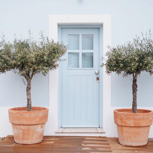#urbanexploration #house #architecture #facade #simpleaesthetics #cleanlines #doorway #pottedplants #olivetrees #terracotapots #symmetry #urbexworld #urbanexploringphotography                                                  #freetoedit