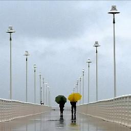 pier umbrellas rainyday couple pcgloomyweather gloomyweather