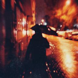 rain umbrella blurred street night