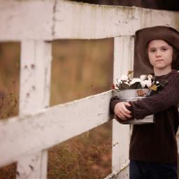 boy cotton fence lines portrait