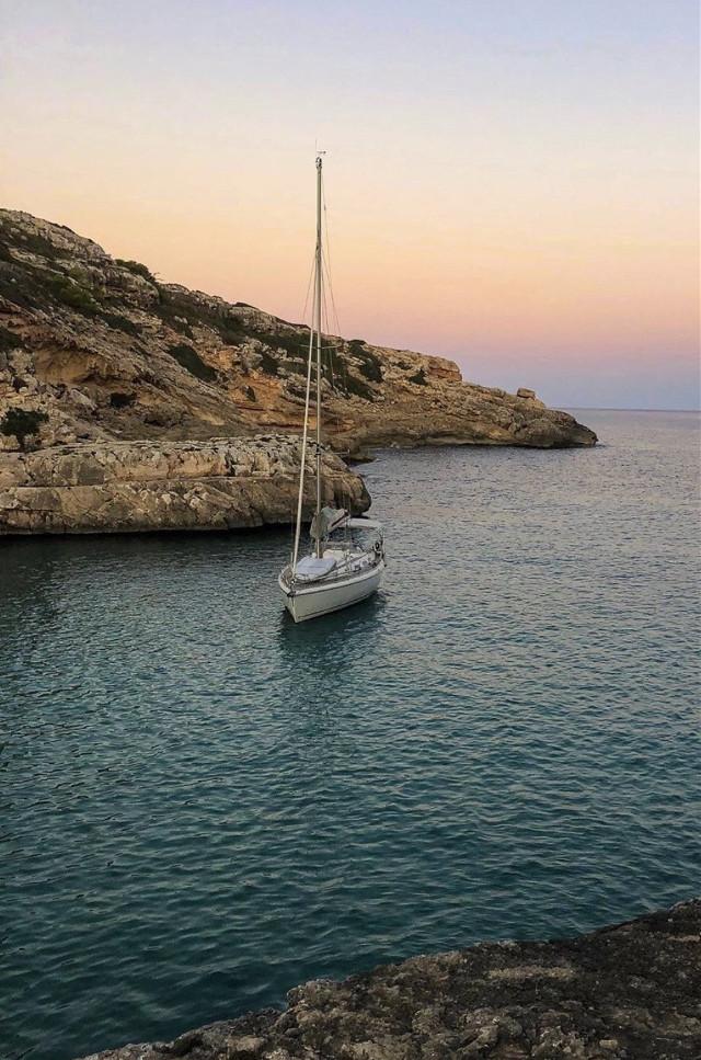 #coastline #sunrise #cliffside #lookingdown #peacefulplace  #seaview #smalcove #calmwaters #rockformations #anchoredboat #sunriselight #peacefulness #highangleshot                                                                             #freetoedit