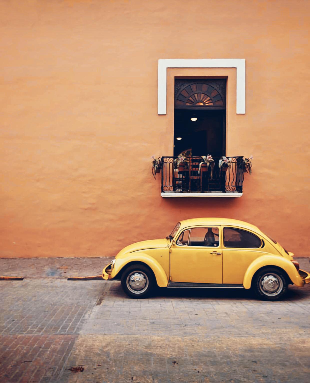 #urbanexploration #housewall #window #balcony #parkedcar #oldcar #wolkswagen #beetle #yellowcar #retro #vintagevibes #minimal #urbanexploringphotography