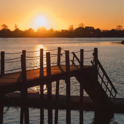 thesungoesdown lakeshore pier silhouettes goldenlight freetoedit