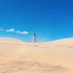 sunday dunes lighthouse blue sky