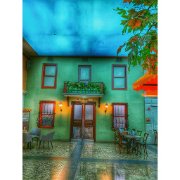freetoedit architecture nopeople entrance builtstructure buildingexterior outdoors restaurant door windows seat nature city chairs business cafe painting sign green wall bluesky tree lowangleview