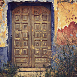 freetoedit urbanexploration abandonedplaces urbex veryoldhouse abandoned forgotten decayed urbexworld grungetexturedwall colorful frontwall door doorway woodendoor wildplants grass nature urbannature decadentbeauty urbanexploringphotography