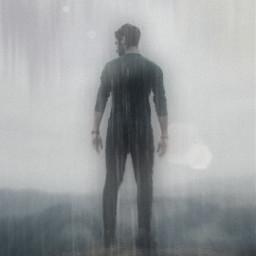glopixa man standing on cliff rain raining mountain mountains lensflare