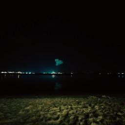 beach sand waterfront sky cloud