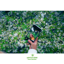 adult mobile plant green flower tree blossom day nature selfportrait holding garden yard laughing hand girl happy freshness